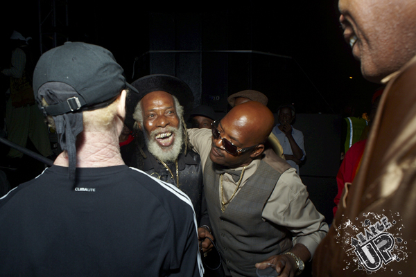 King Yellowman looks on as Josey Wales and Jah Youth share a joke