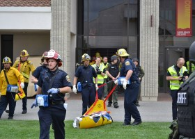 Personnel from the Orange County Fire Authority and the Orange County Sheriff's Department begin to bring out critically wounded students, portrayed by student volunteers, at an active shooter training exercise on Tuesday, March 25, at Saddleback College. (Stefan Stenroos/Lariat Archive)