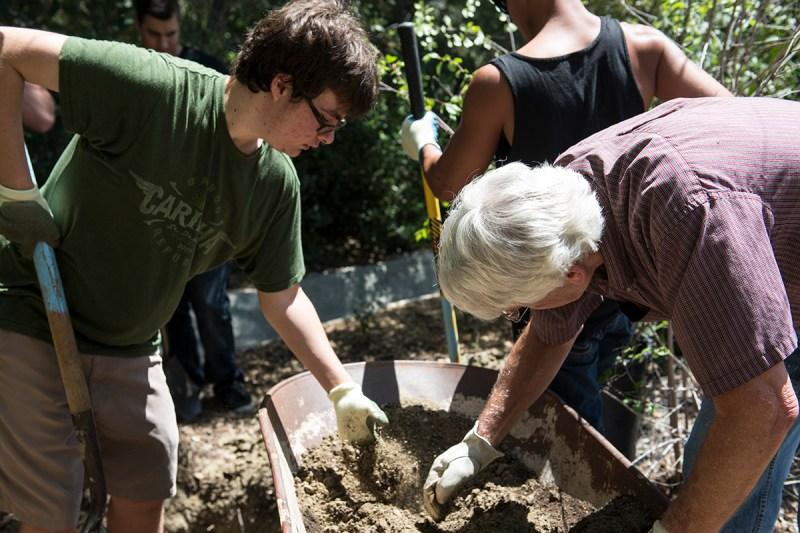 Kyle Hedden, 19-year-old environmental studies major assists Professor John Richards at Saddleback College's Environmental Awareness Club's annual tree planting April 21, 2014.