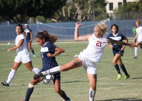 Saddleback player No.21 freshman, Julianna Caldwell battles back trailing 1-0 IVC player Bernice Pacheco (Photographs/Dominic D. Ebel)