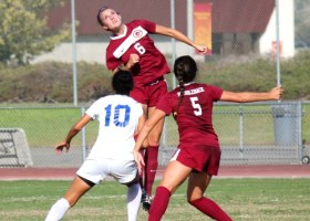 No.6 Emily Winkelmann, defense, sophomore, jumps to block goal attempt. (Photographer/Anibal Santos)