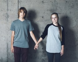 Ayrton Finden, 19, Physics & Anthropology poses with Hana Andersen, 19, Nursing. Two complete strangers holding hands.