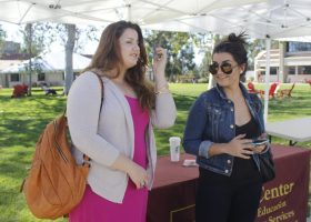 Lending Love Club members, Laura Bouzain and Setareh Kamali are eager to sign up new members at Club Rush.
