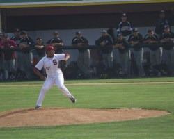 Domnique Key dominating the mound as the El Camino dugout watches. (Niko LaBarbera)