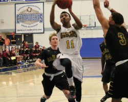 Gauchos guard Maleke Haynes (#11) drives to basket at semi-finals at Cerritos College(Photographer Dominic D. Ebel)