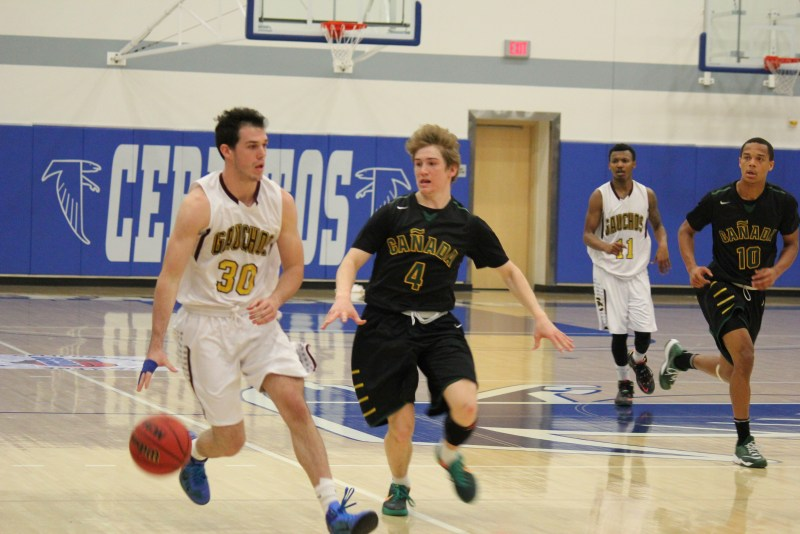 Gauchos sophomore, guard, No.30, Josh Mishler dribbles then gets back to back three pointers against the Colts as sophomore, guard, No.4  Hatch on defense in semi-finals at Cerritos College