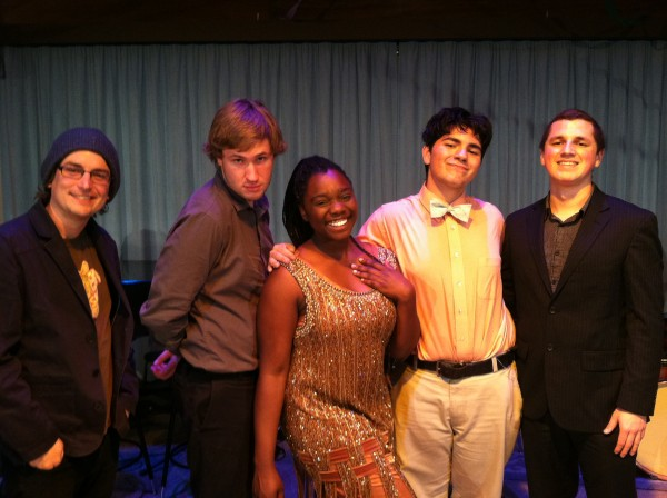 """Performer and event coordinator Gabby Jackson, a Saddleback acting major (center), poses with fellow """"Historic Harlem"""" performers Justin Hershie (far left), Tyler Carmode (left), Julian Strauss (right), and Drew Block (far right), all of whom are music majors."""
