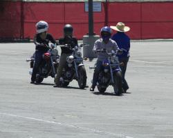 Saddleback motorcycle students enjoying an empty parking lot while learning the rules of the road.