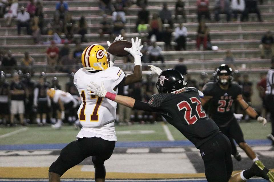 Dominic Collins catches a pass from Stanton for 14 yards to the Santa Ana 44-yard line for a first down in the third quarter.