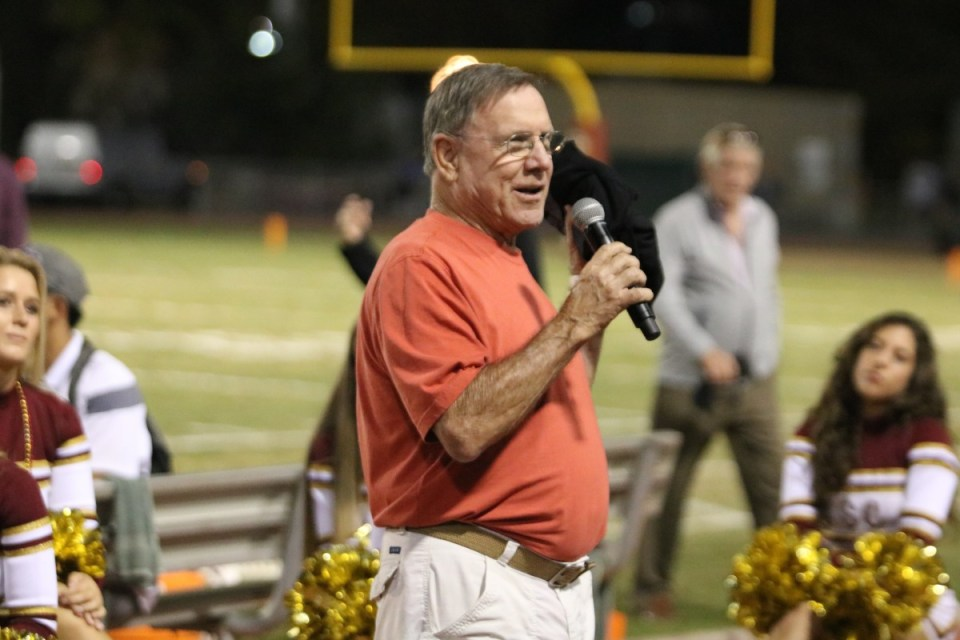 Coach Ken Swearingen speaking during the halftime show as the championship team of 85' was honored. (Kseniya Taranyuk/ Lariat)