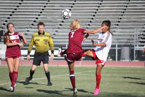 Gauchos sophomore midfielder Danielle Scelsi gets the ball up over the defense in action. (Dominic Ebel/Lariat)