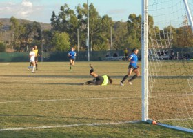 Saddleback keeper Angelica Ramos saves a Santiago Canyon shot. The Gauchos won the game 1-0 behind a goal from Brittney Stevens. (Hailey Weddington/Lariat)