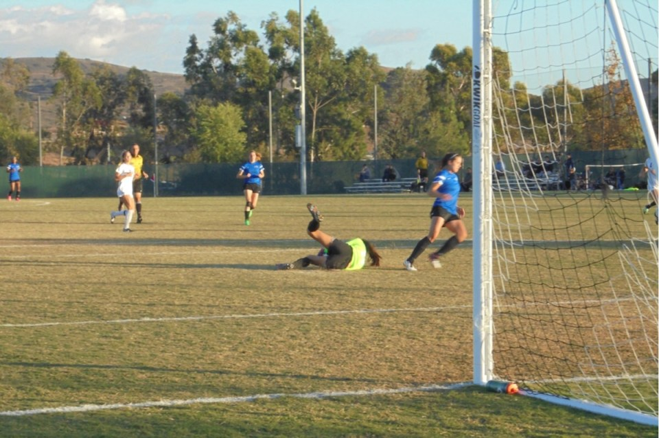Saddleback keeper Angelica Ramos saves a Santiago Canyon shot. The Gauchos won the game 1-0 behind a goal from Brittney Stevens. (Hailey Weddington/Lariat)