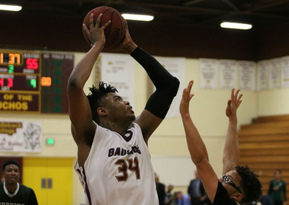 Gauchos forward Breaon Brady (No. 34) shoots over a block attempt. City College of San Francisco shut down Saddleback offensively and the Gauchos could not stop the Rams big man Jalen Canty in the post in the state championship game Sunday. (Nick Nenad/Lariat)