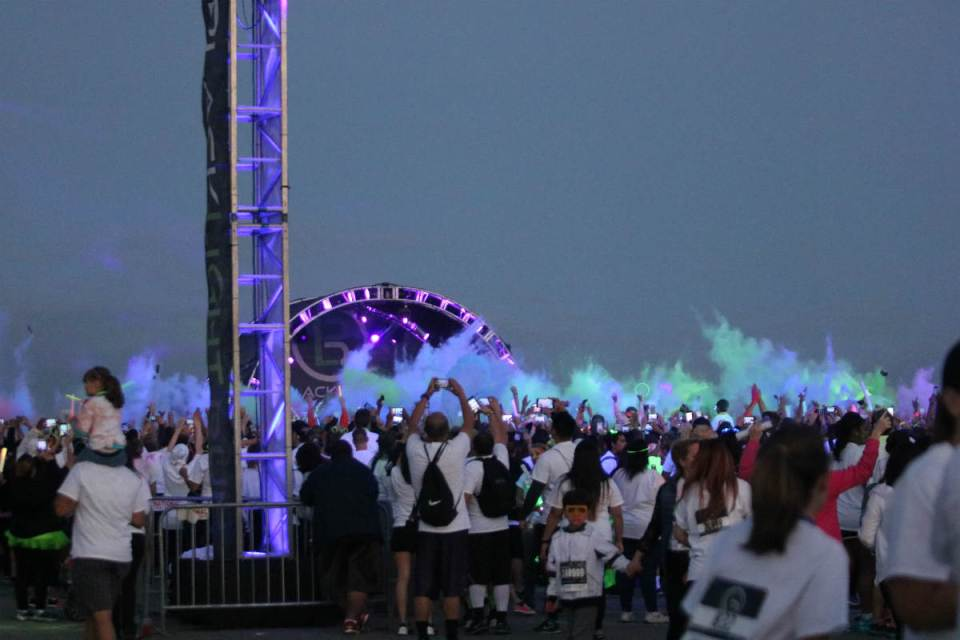 DJ Cochina and DJ Automatic filled the parking lot with energetic music at the Blacklight Run's pre-party in Irvine. (Angel Grady/Lariat)