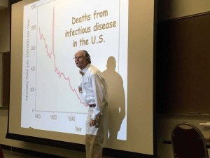 Stanley Maloy shares a graph showing a decrease in deaths from infectious disease in the U.S. (Kurtis Rattay/Lariat)