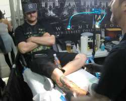Blaine Schuerings getting tattooed by Costa Mesa's Mike Spazbo. Hundreds of individuals were tattooed at Musink throughout the weekend. (Austin Weatherman/ Lariat)