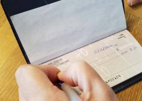 Many young adults are discovering the difficulty of being an adult as they come across simple tasks like properly filling out a check. (Katie Groat / Lariat)