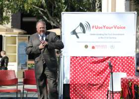 Saddleback College President, Tod Burnett, introducing the Associated Student Government and other affiliates to the stage for the #UseYourOwnVoice event in the quad. (Colin Reef/Lariat)
