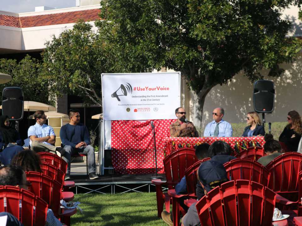 A Panel of Saddleback College students and professors take the stage to discuss applications of the first amendment in the digital age of technology. (Colin Reef/Lariat)