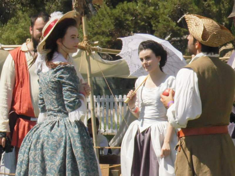 Anita Ziesmann and Elise Andonian in 18th century gowns at the Tall Ships Festival (OC News Team)