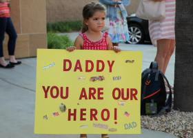 A young girl patiently waits for her father to arrive home at the Orange County Fire Authority in Irvine. (Adam Gilles/Lariat)
