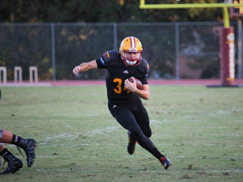 Gauchos Freshman Running Back #34 Connor McBride carries the ball in a win against El Camino (Adam Gilles/Lariat)