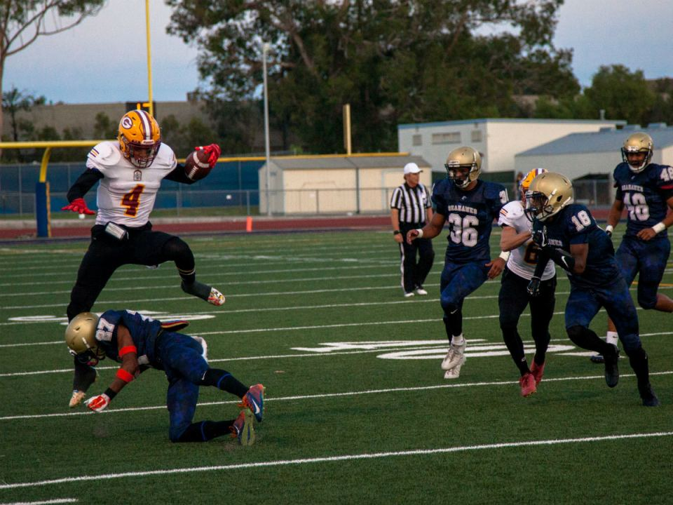 Wide receiver for the Gauchos Lorenzo Thompson hurdles over a Seahawks defender on a screen pass (Colin Reef/Lariat)