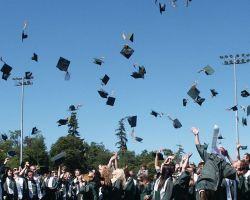 Students of a community college celebrate the end of their graduation ceremony. (Pixabay)