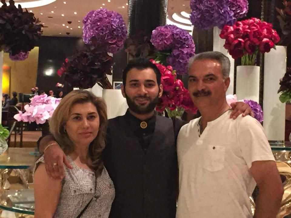 Shayan Mazroei (center) with his parents Shahzad Mazroei (left) and Hamid (right) Mazroei (Saddleback.edu)
