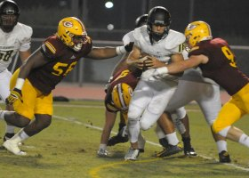 Defensive linemen Jake Hudson and Kimani Keith chase after the Golden West College quarterback. (Cliff Robbins/Foothill Sentry)