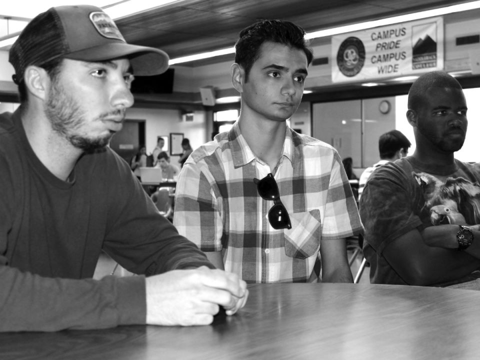 Club officers Michael Cullen (left), Isaac Moridani and Darren Bray finalize plans for the Halloween party Oct. 26. (Austin Weatherman/Lariat)
