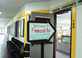 Saddleback College's Financial Aid Office sports on a arrow shaped whiteboard sign providing instructions for convenience. (Daniela Sanchez/Lariat)