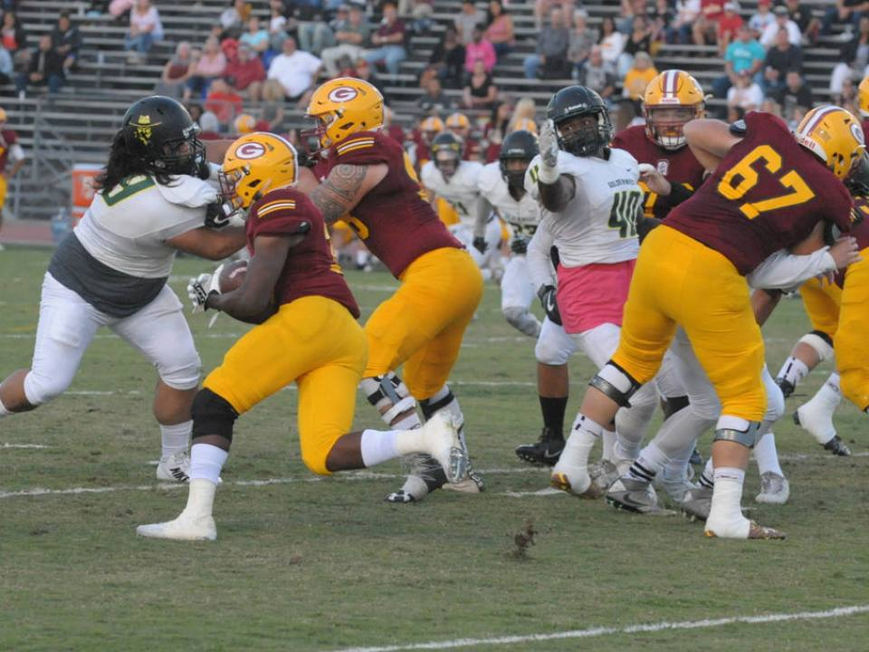 Saddleback College's running back makes his way through the offensive line as he attempts to get to the endzone. (Cliff Robbins/Foothill Sentry)