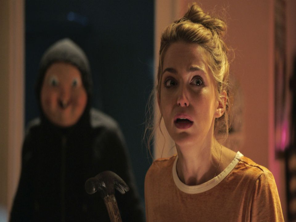 Tree Gelbman (Jessica Rothe) tries to out run the baby face killer not knowing she's too late, he's already behind her. (Courtesy of Blumhouse Production)