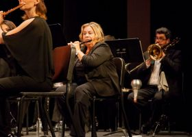 Third chair flute player, Betty Whyte, switches between playing flute and piccolo throughout the concert. (Ally Beckwitt/Lariat)