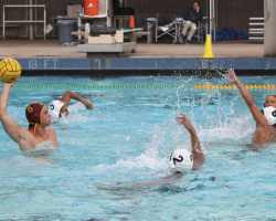 Nathan Benge (left) takes aim to put Saddleback up against Santa Ana College. (Courtesy of John Mourer)