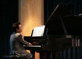 """Andrew Park performing """"Sabre Dance"""" by Aram Khachaturian at the McKinney Theatre. (Colin Reef/Lariat)"""