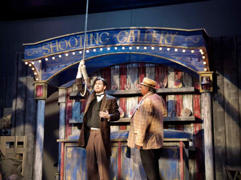 "John Wilkes Booth and the proprietor take stage as they perform a scene from ""Assassins"" (Colin Reef/Lariat)"