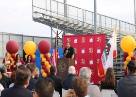 Head Football Coach and Kinesiology Faculty Member Mark McElroy presenting a speech at the Saddleback College groundbreaking celebration on March 12. (Ashley Hern)