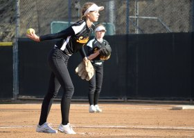 Pitcher Mckenna Walton winding up for a strike. (Andrea Clemett/ Lariat)
