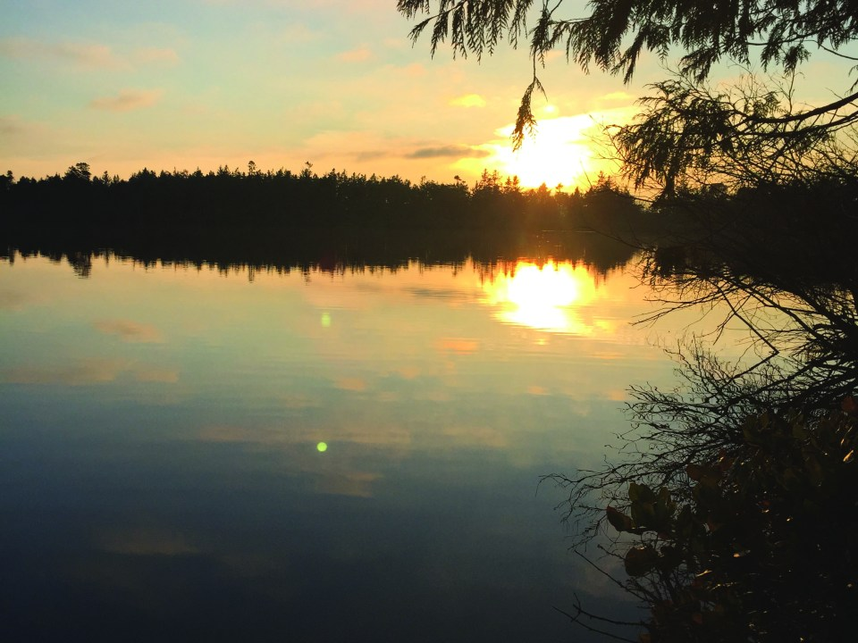 Sunset at Deception Pass State Park in Washington. Photograph by Lizzie Williams.