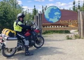 After riding 7,000 miles Scott Fredrickson reaches the Arctic Circle in Alaska. (Scott Fredrickson)
