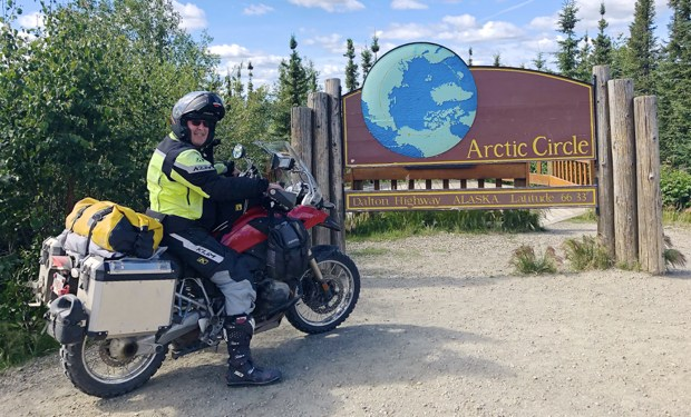 After riding 7,000 miles Scott Fredrickson reaches the Arctic Circle in Alaska. (Scott Fredrickson)