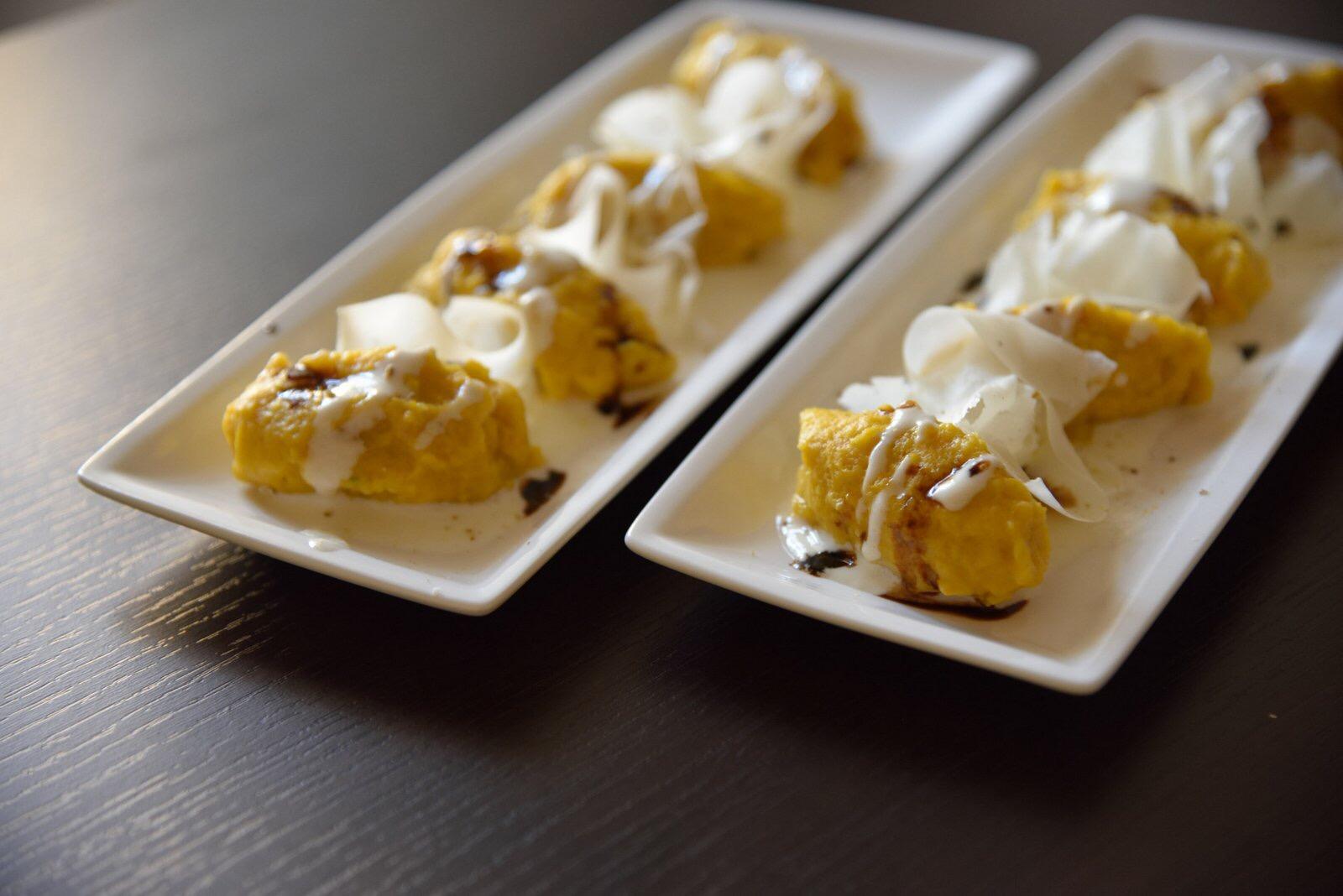 Malfatti di zucca con fonduta e raspadura di parmigiano