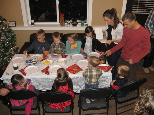 Cousin Julene tells a story to the youngest generation as they wait for their supper to be plated.