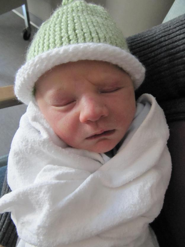 Half a day old. He got the cutest hat from the hospital.