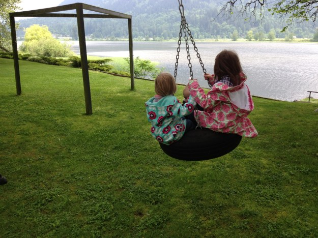 Swinging with cousins.