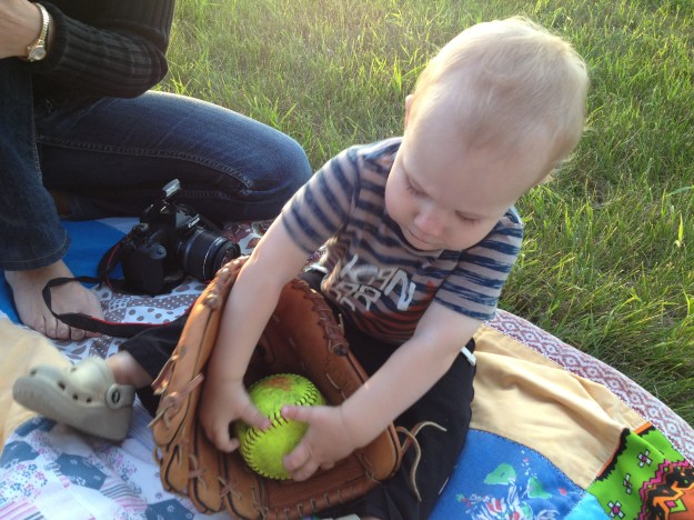 Calvin practiced getting the ball into the glove on the sidelines.
