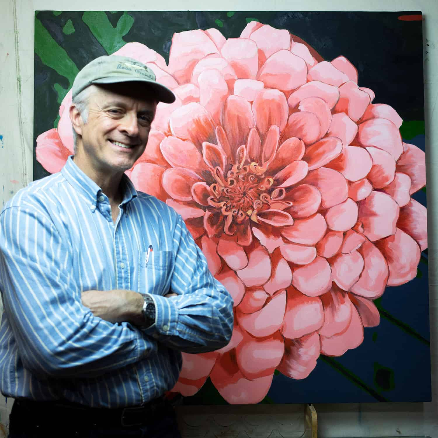 Mark Laurence LaRiviere in front of Pink Zinnia painting